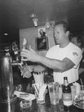 Actor Bruce Willis Working as a Bartender at His Restaurant Planet Hollywood Premium Photographic Print
