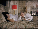 Actress Sophia Loren and Husband, Producer Carlo Ponti, Lying across a Bed Together Premium Photographic Print by Alfred Eisenstaedt