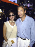 Actor Kevin Costner and Wife Cindy, Wearing Sunglasses Premium Photographic Print by David Mcgough