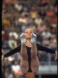 US Gymnast Kathy Rigby Performing on the Balance Beam at the Summer Olympics Premium Photographic Print by John Dominis