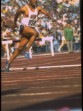 US Track Athlete Eddie Hart Running the 400 Meter Relay at the Summer Olympics Premium Photographic Print