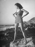 Actress Jane Russell Wearing Bathing Suit, as She Stands on Rocks Near the Ocean Premium Photographic Print