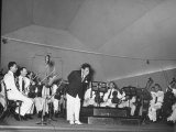 Young Conductor Lorin Maazel Taking a Bow at a Concert by the Robin Hood Dell Orchestra Premium Photographic Print by Nina Leen