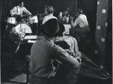 Singer Sarah Vaughn Sitting at Piano While the J. C. Heard Orchestra Plays During Rehearsal Premium Photographic Print by Gjon Mili