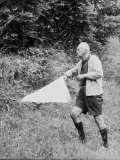 Author Vladimir Nabokov Hunting Down Specimen for His Collection with Butterfly Net in Countryside Premium Photographic Print