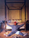 Entertainment Mogul Russell Simmons Relaxing on Bedroom Floor at Foot of Four-Poster Bed Premium Photographic Print by Ted Thai