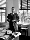 Atomic Scientist J. Robert Oppenheimer Standing in His Office after the Gray Report Was Published Premium Photographic Print by Alfred Eisenstaedt