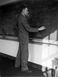 American Physicist J. Robert Oppenheimer Writing on Blackboard at the Institute for Advanced Study Premium Photographic Print by Alfred Eisenstaedt