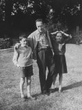 French Author Albert Camus Poised Standing on Lawn, Arms around His Twins Jean and Catherine Premium Photographic Print by Loomis Dean
