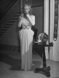 Actress Carloe Landis, Lighting Her Cigarette Premium Photographic Print by Peter Stackpole