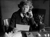Soviet Ambassador to Sweden Alexandra Kollontai Talking on Telephone in Her Office. Circa 1934 Premium Photographic Print by Alfred Eisenstaedt