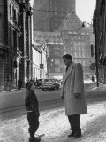 Ice Hockey Player Jean Beliveau, Standing in a Snow Covered Street Speaking to a Child Premium Photographic Print by Yale Joel