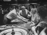 Entertainer Dean Martin Acting as Dealer at a Casino Premium Photographic Print by Allan Grant