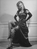 Actress Carole Landis Wearing Many Garters on Leg at Garter Party for Hollywood Correspondents Premium Photographic Print by Martha Holmes