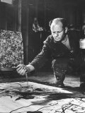 Artist Jackson Pollock Dribbling Sand on Painting While Working in His Studio Premium Photographic Print by Martha Holmes