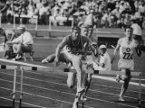 Glenn Davis Winning 400 Meter Hurdles Event Race W. Finland's Rintamaki at Olympics Premium Photographic Print
