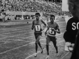 Abebe Bikila and Mamo Wolde in Exhibition Race at Berlin Olympic Stadium Premium Photographic Print