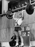 Iranian Weight Lifter M. Namdjou Struggling to Hold Up 206.5 Pound Weight at 1952 Olympics Premium Photographic Print