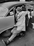 French Actor Jacques Tati Comically Getting Out of a Cab Premium Photographic Print by Yale Joel
