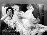 Actress Geraldine Page with Painting of Herself Premium Photographic Print by Peter Stackpole