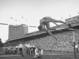 High Jumper Verne Mcgrew in Mid-Jump in an Attempt to Qualify During the U.S. Olympic Tryouts Premium Photographic Print by Ed Clark