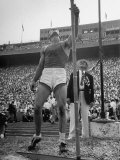 Athlete Harry Cooper Looking at the Height of the Jump During the Olympic Tryouts Premium Photographic Print by Ed Clark