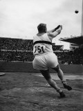 J. Csermak of Hungary Winning Hammer Throw with Olympic Record Premium Photographic Print