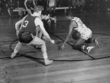 Harlem Globetrotter Marques Haynes Dribbling the Ball While Playing a Basketball Game Premium Photographic Print by J. R. Eyerman