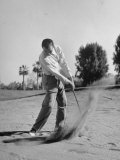 Golfer Ben Hogan Playing Golf in Sandtrap Stampa fotografica Premium di Martha Holmes