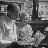 Painter Jackson Pollock Looking at Drawings with Woman Premium Photographic Print by Martha Holmes