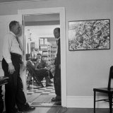 Painter Jackson Pollock Standing in Doorway Near One of His Paintings Premium Photographic Print by Martha Holmes