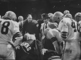 Coach Paul Brown Speaking to the Cleveland Browns Football Team from the Middle of the Huddle Premium Photographic Print