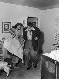 Married Actors Orson Welles and Rita Hayworth Pretending to Bullfight at Home Premium Photographic Print by Peter Stackpole