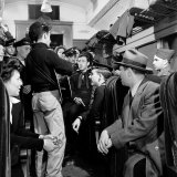 Folk Singer Woody Guthrie Performing for Small Group Aboard a Train Premium Photographic Print