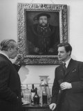 Actor Robert Donat Standing Holding Drink with Alexander Korda under Portrait of Henry Viii Premium Photographic Print