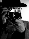 Photographer Henri Cartier-Bresson Wearing Hat and Holding Camera Up to His Face Premium Photographic Print by Dmitri Kessel