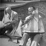 Artist Lyonel Feninger and Lux Feninger, Repairing Model Boats before Racing Them Premium Photographic Print by Andreas Feininger