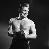 Actor Kirk Douglas in a Boxing Pose Premium Photographic Print by Allan Grant