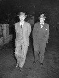 Physicist J. Robert Oppenheimer Walking with His Lawyer Lloyd K. Garrison Premium Photographic Print by Ralph Morse