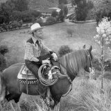 Actor Gene Autry Astride His Horse Championn Surveying His Ranch Premium Photographic Print by Loomis Dean