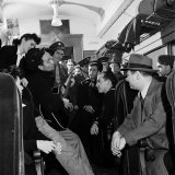 Folk Singer Woody Guthrie Playing His Guitar for Commuters on a Subway Train Premium Photographic Print