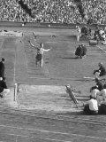 Athlete Competing in Long Jump Premium Photographic Print