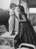Actress Anna Magnani Posing with Child Standing on Table Premium Photographic Print