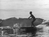 16 Yr. Old Surfer Kathy Kohner Riding a Wave Premium Photographic Print by Allan Grant