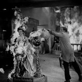 "Actor Vincent Price Putting Out Fire in Film ""House of Wax"" Premium Photographic Print by J. R. Eyerman"