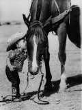 Jean Anne Evans, 14 Month Old Texas Girl Kissing Her Horse Premium Photographic Print by Allan Grant