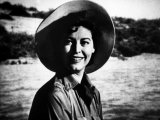 """Actress Ava Gardner Smiling in a Scene from the Film """"Mogambo"""" Premium Photographic Print by Peter Stackpole"""