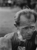 Emil Zatopek Sitting Tensely with Furrowed Brow after Winning Second of Three Olympic Races Premium Photographic Print by Ralph Crane