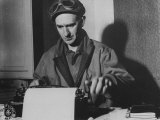 Famed Journalist and War Correspondent Ernie Pyle Working at Typewriter Premium Photographic Print
