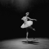 Ballerina Margot Fonteyn in White Costume Balanced on One Toe While Dancing Alone on Stage Premium Photographic Print by Gjon Mili